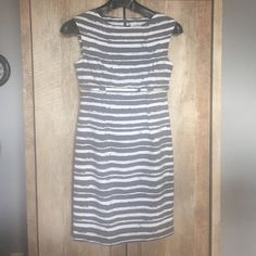 Like new Calvin Klein dress size 8 Calvin Klein grey and white sheath dress. Like new - only worn once. ***Belt included*** Fully lined dress with invisible zipper. 63% polyester 33% rayon 4% spandex Lining 100% polyester Very flattering darts. Sits just above the knee. I can give measurements if needed. Calvin Klein Dresses