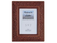 $48 How about a beautiful 5x7 leather picture frame for a Father's Day gift? This frame is amazingly lovely and would go well with many different decors. It is embossed with a horse and floral design so you will love this for your leather home decor!