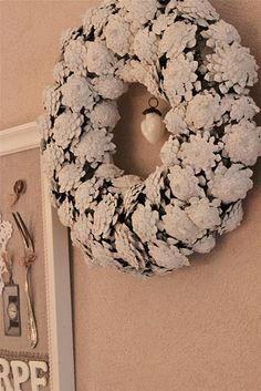 Upside down pinecones, hot glue & paint create a wreath