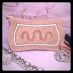 Art Deco Style Petite Beaded Clutch Vintage Art Deco Style, beaded clutch, beige beading , several beads are missing, they are inside and can be repaired on, old fashion style clutch, zipper closure, really cute clutch . Original sticker remains attached inside. Very Pretty. From the 1930s-40s era approximately. Art Deco Bags Clutches & Wristlets