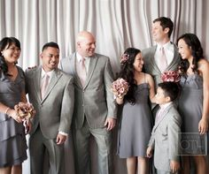 The bridesmaids, groomsmen and ring bearer laugh together after the ceremony.
