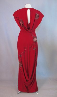 ~This 1940 gown was sold by Maison Mendessolle, a very exclusive and expensive women's shop located in the luxury St. Francis hotel in San Francisco's Union Square. The entire dress is decorated with red sequins and clear seed beads in a floral motif~