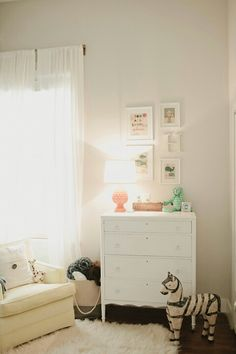 Love the white simplicity with touches of color.  Could add pom poms to the curtains.  Need a bigger dresser for a changing station?