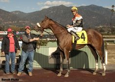 Gary Stevens in the winners circle at Santa Anita after winning his first race since he came out of retirement