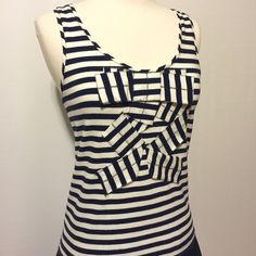 "Kate Spade Navy & White Cascading Bow Knit Tank Navy and white knit stripe tank with cascading self bow accent. 95% cotton 5% elastane Machine washable 22"" overall length kate spade Tops Tank Tops"