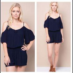 """NWT Navy Romper Sz S A junior half sleeve romper with open shoulders with narrow straps. Elasticized waistline. Flared. A self tie on front near the bottom of neckline. Hem finished.  100% Rayon Hand Wash Cold Imported  Model is wearing size S Model is 5' 10"""" Pants Jumpsuits & Rompers"""