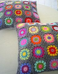 granny squares cushion covers: LOVE the gray background and the bright colors!