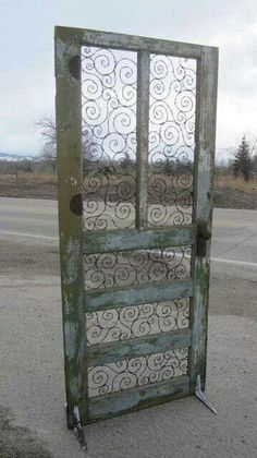 of Barbed Wire In Upcycled Door Barbed wire spirals take the place of panels and glass. It stands with the help of old, shelving brackets.Barbed wire spirals take the place of panels and glass. It stands with the help of old, shelving brackets.
