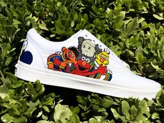 *Please allow 3 to 4 weeks for delivery of any custom order* KAWS x Sesame Street collaboration. Vans Old Skools. Waterproofed with beeswax. Custom Vans Shoes, Custom Painted Shoes, Painted Vans, Air Force One Shoes, White Canvas Shoes, Creative Shoes, Aesthetic Shoes, Baskets, Fresh Shoes