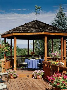 Grand Gazebo-Construct a gazebo on a portion of your deck to alleviate the inconvenience of unwanted sun during an outdoor lunch. This cedar deck is supported by 10 wooden posts and is surrounded by vertical plank cedar railing