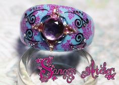Ring art with Konad stamp, stickers and strass