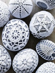 river rock wrapped in doilies..would make a great addition to any centerpiece you could get the rocks from the beach house and doilies from thrift stores or online.  So cute