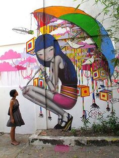 Graffiti Street Art - woman squatting with umbrella (colorful)