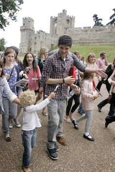 I can't handle how precious this is. Look at all the little Merlin fans!