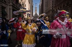 ... Revellers in fancy dress participate in the annual Mummers Parade in Philadelphia on January 1 2017 ...