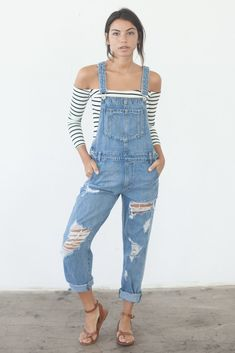 """Details Size Shipping • 100% Cotton • Distressed oversized overalls • Hand Wash • Line dry • Imported • Measured from small • Length Adjustable """" • Rise 21"""" • W"""