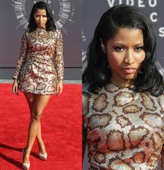 "With a song called ""Anaconda,"" did you think Nicki Minaj would turn up to the VMAs in anything other that a super-short snake-print dress? But her wild look was tamer than you'd imagine. The sparkly frock's long sleeves helped it from becoming too risque. (She had to save something for the stage.) Nicki finished off the sexy look with leg-lengthening nude heels and minimal makeup."