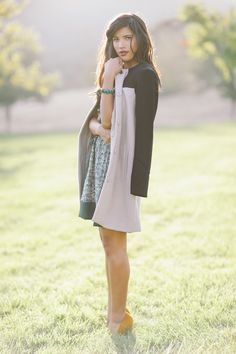 A neutral coat with a printed dress exudes effortless chic! #ruche #shopruche