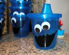 Cookie Monster sippy cups, googly eyes and a black paint pen on blue plastic cups
