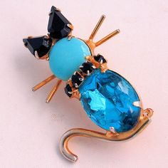 Vintage Kitty Cat Pin Turquoise Blue Cabochon Rhinestones Gold Tone from Antik Avenue on Ruby Lane