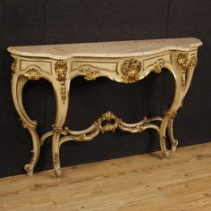 French console table of the 20th Century. Furniture in carved, lacquered and golden wood of top quality. Top floor in original marble restored over time
