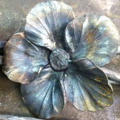 steel flower -- possibly the recipient of a pouring crucible, or on an anvil, or inside of a crucible or...