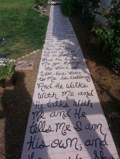 """I hated the walk way to my front door. So I decided to paint it using concrete paint. Next I used chalk to write out the hymn """"I come to the garden alone"""" once I liked how it looked, I took chalk board paint and went over the chalk lettering. Once that dried I sealed it with modge podge spray."""