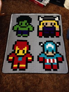 8 Bit Avengers Blanket by by jessicajamey - Done by making squares of 5 rows of 5 single crochets with a size 5 mm (h) hook and super saver yarn.