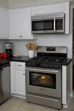 Stove at the end of a counter run. Bosch Freestanding Range and Microwave by BoschAppliances. I need a solution so little hands dont touch hot pots! Home Kitchens, Kitchen Remodel Small, Kitchen Design, Small Kitchen, Microwave In Kitchen, New Kitchen, Freestanding Stove, Kitchen Layout, Kitchen Redo