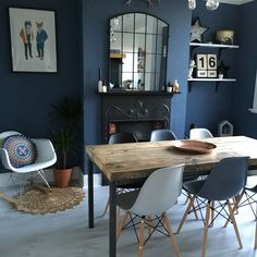 Dining Room decor ideas - modern eclectic style with dark blue walls, rustic wood slab table, grey and blue Eames chairs, small fireplace and graphic artwork.Little Greene Juniper Ash Dining Room Colour Schemes, Dining Room Colors, Dining Room Design, Lounge Design, Kitchen Design, Dining Decor, Dining Room Furniture, Living Room Decor, Furniture Ideas