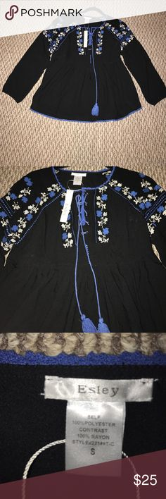 Lace up embroidered baby doll top Elegant baby doll top with beautiful lace up and embroidered details. Tops Blouses