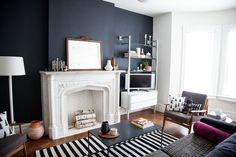 Anna Dorfman's fireplace and black walls!