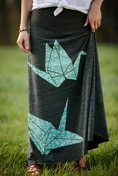 Ever since we released our patterned paper crane design in the Fall of 2015, we've barely been able to keep it in stock. Pullovers, scoop neck tees, and scarves alike--it's clear that everyone else lo