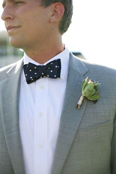 Grooms navy bow tie with white polka dots