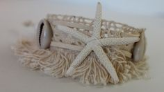 item #B082 The star of the ocean wrap- is made of sea stars and large cowrie shells all sewn on lace with adjustable faux suede cords.
