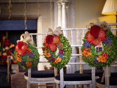 End aisle decorations are always appealing for guests to admire. These autumn inspired wreaths are the perfect choice.