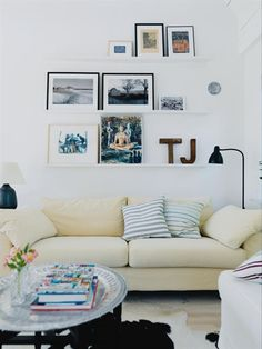 digging this photo arrangement, i have some picture rails and needed some inspiration like this!
