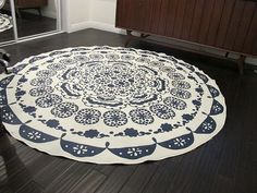 turn tablecloth into a rug! roll on 3 coats polyurethane then use spray adhesive to attach a rug pad to it! and that's all there is to it. Use in a low traffic area. Many possibilities here