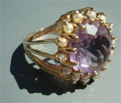 Gorgeous pale lavender faceted amethyst ring is surrounded by 14 pearls. It was custom made in the late 80s and never worn. Size 7 ring. In excellent condition.    Gold weight - 4.3dwt., 14 KT Amethyst - A Quality Cut - 12 mm Round Approximately 4 1/2 carats 14 Pearls - A quality (information from local jeweler)    The ring will come to you in its green box, as shown in the photo. Appraised for $895.00.    Shipping via priority mail with full insurance and signature confirmation. Layaway...
