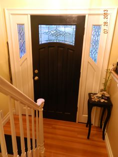 My black painted front door . Watch my video for my small but personality packed foyer tour. Go to My Screendoorgirl 3 Videos Board .