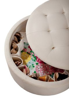 Lily Pulitzer Rousseau ottoman w/ hidden shoe storage.  I could possibly DIY this with any ottoman that doubles as storage.