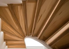 London studio 51 Architecture has combined digital fabrication with boatbuilding techniques to create a sculptural timber staircase at the centre of a family home.