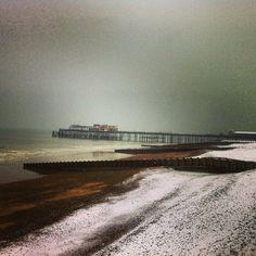 Snowy beach and Hastings pier