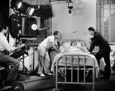 FRANK BORZAGE, Spring Byington and Errol Flynn on the set of Green's Light (1937)