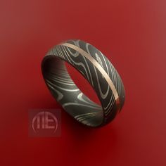 Damascus Steel 14K Rose Gold Ring Wedding Band Custom Made to Any Size3-22. $298.92, via Etsy.