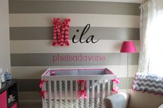 bright pink and grey baby bedding | pink flowers as the first letter and pink name below