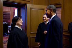 President Barack Obama talks with Justice Elena Kagan and Chief Justice John Roberts before Kagan's Investiture Ceremony at the Supreme Court, October