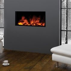 From the sensational Studio Electric Inset fires to Gazco's contemporary 670 electric fires , these built-in electric fires will add stylish warmth to almost any room in your home with the ultimate ease. Living Room Colors, Living Room Modern, Living Room Designs, Modern Electric Fires, Contemporary Fireplace Designs, Furniture Placement, Cheap Furniture, Deco Furniture, Home Staging