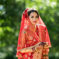 Bride In The Red Dress. Nepali Indian bride wearing red Saarinen with a red veil. Wedding Photography by MnMfoto. Www.mnmfoto.com