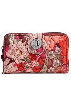 """Meet the Vera Bradley Turnlock Wallet in the festive Bohemian Blooms pattern.  This wallet features rows of card slips (12!) three expandable areas for bills and a zippered coin pouch providing organizational bliss! It even has two additional convenient ID windows. The zip-around closure adds extra security and the silver-toned turn lock closure gives it high style. e design and it has a stylish leaf silhouette print lining. Spot clean only.    Dimensions: 7 """" wide x 4 """" high.  Bohemian…"""